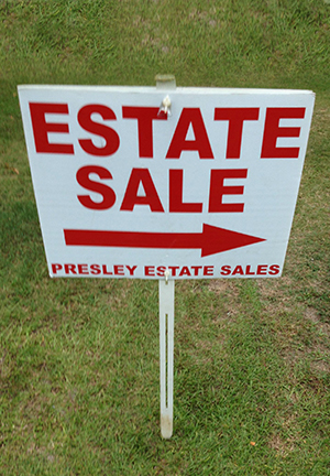 lawn sign at an estate sale
